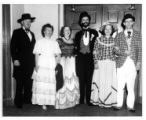 1950 Group of men and women in period costume.