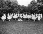 Young ballerinas performing outdoors.