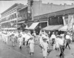 Men and women marching in a parade