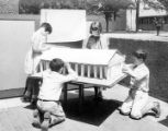 Children constructing a building model