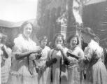 Women enjoying refreshments in the quad