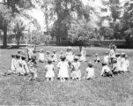 Children playing on the grass at San Jose State.