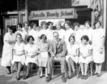 Group portrait of Annette Beauty School staff and students