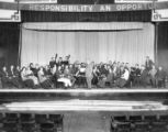 Conductor and orchestra on stage