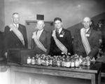 Four grange men with jars of money
