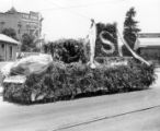 Foliage covered parade float