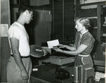 1951, Old Post Office building,  Peggy McDaniel and  patron
