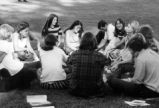 Students sitting in a circle.