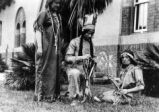 Three people in Native American dress.