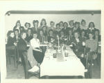 Group of women gathered around dining tables