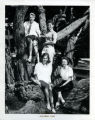 Four teenage girls posing on a cypress tree in Asilomar