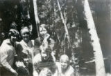 Group portrait of six teenage girls in the forest