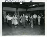 Men and woman learning to dance