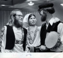 Two men and a women in traditional folk attire.