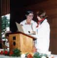 Lois Cullison receives a certificate from Susanne B. Wilson