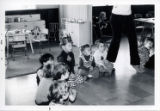 Group of children sitting on the floor