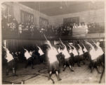 Female youths performing in the YWCA gym