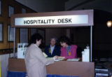 Women standing at a hospitality desk