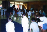Children bowing to their instructor