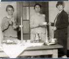 Three women serving refreshments