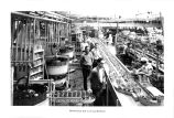 Cannery workers by distributing belt to syrup machines.
