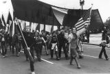 Marchers led by man with America flag