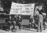 Women on park benches with banner