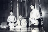 Patricia Whiting beside Governor Tom McCall as he signs a bill