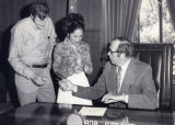 Patricia Whiting receiving pen from governor
