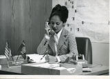 Patricia Whiting taking phone call at her desk